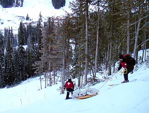 Mike Henness schlepped by ski patrol at Sun Peaks, Canada, 2005.